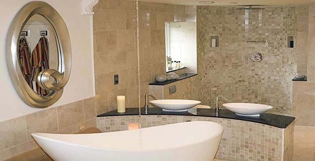 Modern Bathroom with marble tiles and white utilities